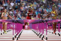 American Dawn Harper, middle, competes in the women's 100-meter hurdles semifinals Tuesday, Aug. 7. She went on to finish second in the final and earn a silver medal.