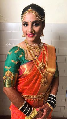 Pavithra looks like a vision in her bridal avatar for her muhurtam. Hair and makeup by MUA Vejetha for Swank. Coral lips. Bridal jewellery. Bridal hair. Saree blouse design. Eyebrows on fleek. Indian bride. South Indian bridal makeup. Jhumkis. Nose ring. Maang tikka.