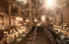 Chandeliers, high candle placement, custom beer bottles for guests
