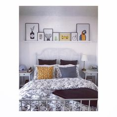 Picture ledge above Ikea's Leirvik Kingsize bed. Prints from app FY, frames from best4frames.com, bedding Ikea, cushions H&M home, throw Dunelm. Bedside tables Ikea. (Yes I love Ikea)
