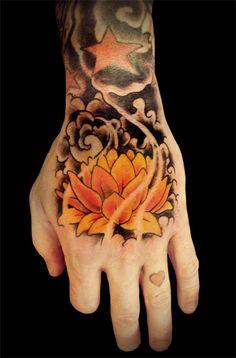 Lotus Flower Hand Tattoo by calico1225.deviantart.com