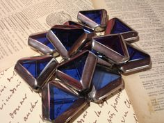 4 Ultramarine Blue Silver-Edged Triangle Beads, Great for Pendants - $3 start bid in the Supplies with a Surprise LIVE Tophatter.com auction. Come get some deals in this fun auction with real time bids, and a FREE surprise with every item purchased.