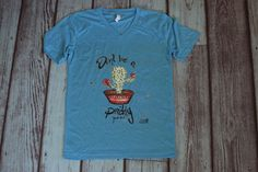 You are bound to get some giggles wearing this prickly pear tee shirt  Electric blue/turquoise printed graphic tee shirt  fits uni-sex.   | Shop this product here: http://spreesy.com/saddles-lace/502 | Shop all of our products at http://spreesy.com/saddles-lace    | Pinterest selling powered by Spreesy.com
