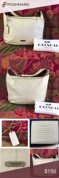 COACH PEARL WHITE AVERY HOBO BAG COACH PEARL WHITE AVERY HOBO BAG .Silver Hardware Zip Top Closure. Classic navy satin lining . One Interior side Zip pocket . Two side cell pockets . Size reference in last photo . Measurements 12 wide 9 high 2 in side width . Hook lock Handle with 6 inch Drop . Coach pebbled leather . Coach Dust Bag included. Preloved in excellent condition one tiny flaw not really noticeable but I tagged it with a pink dot in the third photo. Priced accordingly. This Bag is…