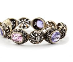 Vintage bracelet of 18 karat yellow gold and sterling silver, set with pink and purple sapphires and diamonds. Created in Italy, circa 1920.