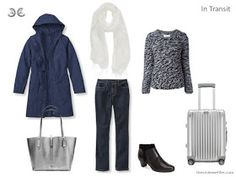 In transit. Travel capsule wardrobe in a navy, white, and grey color palette