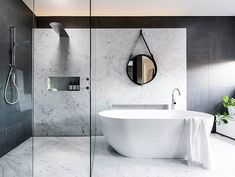 #reposrt @norfloor_fliser #welovenew An incredible bathroom with both a walk in shower and free standing bath.