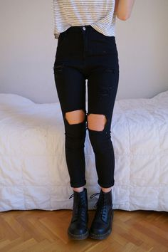 Striped shirt, black distressed jeans and black combat boots