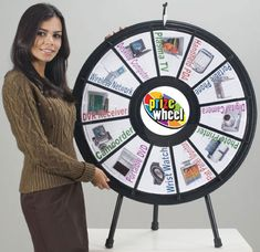 """The 12-Slot Tabletop Prize Wheel is our original and most popular Wheel size. Measuring 31"""" in diameter and priced at $279.99, this Wheel can be customized with your prizes and logo using the Custom Game Gizmo from PrizeWheel.com. Travel and carrying cases are available to protect your game. Prize Wheel, Black Wheels, Black Table, Trade Show, Bat Mitzvah, Thing 1 Thing 2, Slot, Tabletop, Cases"""