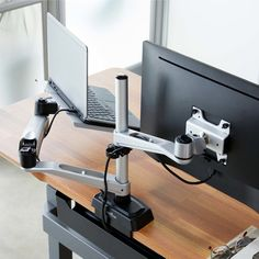 Clear up your VARIDESK desktop by using the Monitor Mount with Laptop Cradle. Gain a new perspective by positioning your display and laptop side-by-side to use both screens together.