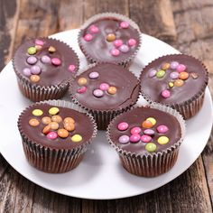 That break from chocolate didn't last long. Simple chocolate and vanilla cupcakes topped with milk chocolate - melted down with some butter so that it doesn't set too hard and topped with smarties