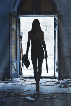 Woman with a gun by Janny Dangerous
