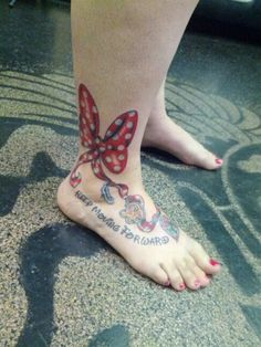 """Minnie's bow with the Cinderella's slipper, Simba Symbol, and Stain Glass Rose from Beauty and the Beast. With thw quote """"Keep Moving Forward"""" by Walt Disney. Was so worth the pain."""