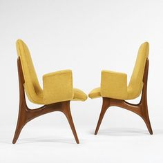 Vladimir Kagan  					armchairs model #176/E, pair      					  						Kagan-Dreyfuss, Inc.USA, c. 1959 walnut, upholstery 25 w x 28 d x 39 h inches. s10