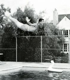 Dean Martin diving into a pool.