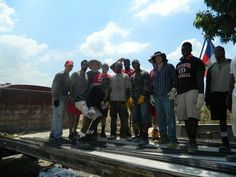 Rutgers football team members spend spring break in Haiti to help rebuild a school and church and spend time with kids.