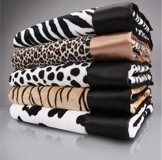 Love these animal print towels.. Great for a black & white bathroom!