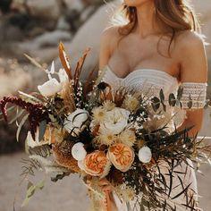 This bouquet is as dreamy as they come!   Thanks for sharing Jordan Voth: Photographer ⚡️   📸 Jordan Voth   Florals: Foxtail Florals   Dress: Rue De Seine Lovely Bride   Bride: Lauren Rote
