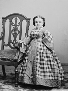 Lavinia Warren (1841-1919).  Lavinia and her sister had a type of dwarfism caused by a problem with the pituitary gland.  She became a school teacher at age 16, but then became a singer and dancer on a cousin's riverboat.  She met Charles Stratton (Tom Thumb) and married him in 1863.  They made a fortune together touring with P.T. Barnum.  After his death in 1883, she married Count Primo Magri, an Italian dwarf.