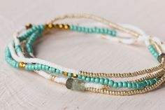 Brighten your day with this gorgeous beaded wrap bracelet in shades of turquoise, white and gold with moss aquamarine rondelles and gold tone