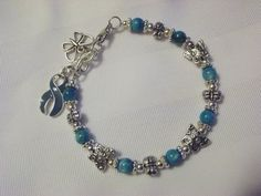Teal awareness bracelet with butterflies for PTSD, food allergies, and more.