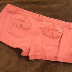 cute Hollister stretch shorts Salmon colored shorts. In good condition. Only worn twice Hollister Shorts Skorts