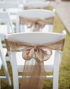 Pretty way to spruce up the white chairs for our ceremony