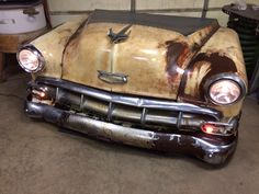 1954 Chevy front clip made into a functional desk made by relics awry.