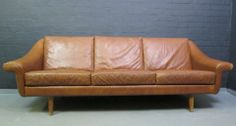 £695  Danish 3 seater leather sofa with leather stitching