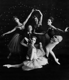 George Balanchine, Suzanne Farrell, Patricia McBride, Violet Verdy, & Mimi Paul (c.1964). Photograph by Edward Pfizenmaier. Pfizenmaier (born in 1926) is well known for his photographs depicting New York City scenes, fashion, and celebrities. Here, George Balanchine, co-founder and balletmaster of the New York City Ballet, is surrounded by four eminent ballerinas from his School of Ballet. They were in the original cast of Jewels.