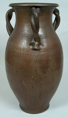 """North Carolina art pottery jar, three double strand twisted handles, stamped twice on the bottom, """"A.R Cole"""
