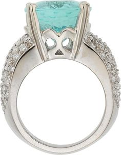 Paraiba Tourmaline, Diamond, White Gold Ring The ring features an oval-shaped paraiba tourmaline measuring 16.75 x 12.87 x 8.68 mm and weighing 11.19 carats, enhanced by full-cut diamonds weighing a total of approximately 1.40 carats, set in 18k white gold. An AGL Laboratory report # CS 1077140, dated July 27, 2016, stating Natural Tourmaline, Paraiba-Type, Origin Nigeria, Clarity Enhancement: None, accompanies the tourmaline. Gross weight 17.40 grams.