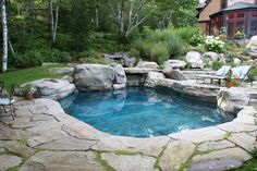 Natural Stone pool | Natural slabs create pond like swiming pool deck