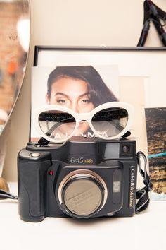 Inside Artist and Model Carlotta Kohl's Closet: White Frame Sunglasses | coveteur.com