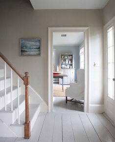 SLIDE SHOW: Terry John Woods' Summer House shows the quaintness of a narrow door.  Screams old farmhouse. #coastallivingroomsstairs