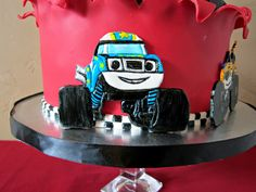 "I've never heard of ""Blaze and the Monster Machines,"" until now!  I had a hard time finding pictures of the trucks for this cake, but it wa..."