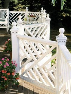 Chinese Chippendale deck railing. How gorgeous the outdoor place is. The Chinese Chippendale rails layout express movement and flow. Check out the topper of the wooden pillar, it's beautifully curved. And I especially love the way this one winds around which are usually straight.