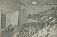 """The interior of the Town Hall as photographed in the 1920s or 1930s. The hall was designed on """"democratic principles,"""" with acoustics engineered specifically for public speaking."""