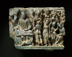 The relief shows Prince Siddhartha being beleaguered by the beautiful daughters of the demon Mara. The girls were supposed to keep the prince from his meditation, but Siddhartha resisted them and attained Enlightenment, thus becoming a Buddha. AD 2nd century ~ AD 4th century Museum Rietberg Zürich