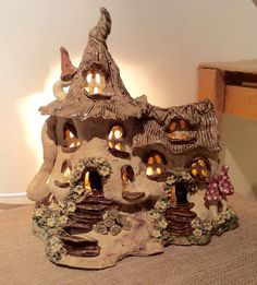 Thatched cottage lamp with some magical spotted toadstools. Sallyamoss www.ceramiccrafts.com