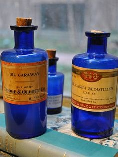 vintage blue glass apothecary bottles - I love collecting old remedy bottles :)