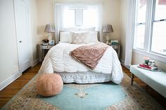 Allison from Team LC demonstrates how to perfectly place a rug in her bedroom.