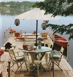 I would love to live on a peaceful lake with a dock like this :)