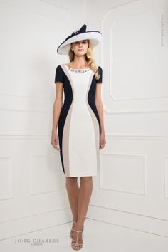 A fabulous silhouette styled mother of the bride outfit by John Charles. A crepe dress with cap sleeves, block coloured panel design, with matching jacket