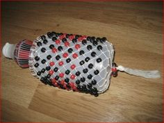 MyMusicalMagic: How to Make a Shekere (African Gourd or Bottle Shaker). This website has a lot of other good ideas for homemade musical instruments