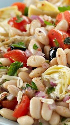 Mediterranean Bean Salad 1 can fl mL) white kidney beans, drained 1 can fl mL) artichoke hearts, drained, quartered 1 cup halved cherry tomatoes cup Cracker Barrel Shredded 4 Cheese Italiano Cheese cup pitted black olives Mediterranean Dishes, Mediterranean Diet Recipes, Vegetarian Recipes, Cooking Recipes, Healthy Recipes, White Kidney Beans, White Beans, Black Beans, Green Beans
