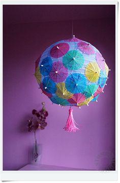paper umbrellas stuck into shop-bought paper sphere