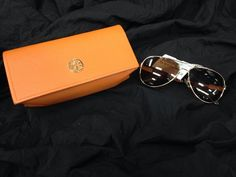Get ready for those sunny spring days with a killer pair of #ToryBurch shades! These beauties are so cute for any face shape, and come with a fun citrus-coloured case – Find them at #PlatosClosetBarrie for just $50! #lovethem #musthave #sunnies | www.platosclosetbarrie.com