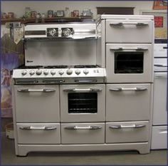 This 1949 Aristocrat by O'Keefe & Merritt features a double oven, 2 broilers, a warming oven, and 6 burners. I'd be willing to donate a kidney for it.