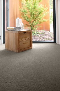 A plush pile carpet in a dark neutral hue highlights the natural beauty in light timber furniture. Yellow Carpet, Dark Carpet, Best Carpet, Carpet Colors, Grey Carpet Bedroom, Living Room Carpet, Carpet Manufacturers, Neutral Bedrooms, Timber Furniture